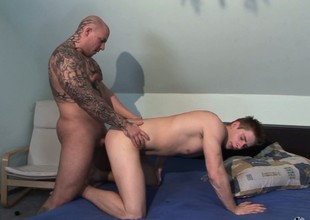 He must be dreaming that a tattooed stud is cramming a hard dick in his booty
