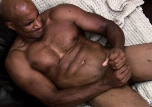 Hung ebony muscleman working hard to rub a load of jism relish in his hindrance