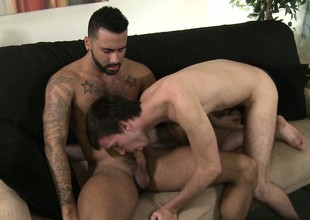 Aaron Slate reaches over and strokes both cocks, then sucks his cock