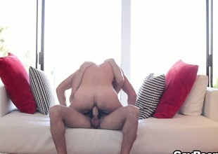 Twink moans noiselessly while taking his hung lover down give the base