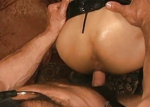 Slaves with leather confine top breeding scene