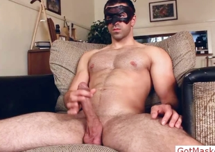 Masked dude stroking plus wanking