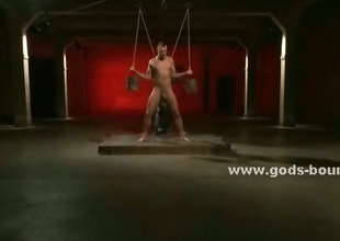 Sex slave gets his ass pierced by an anal hook after being have to suck his Polished dick