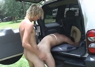 Handsome farmer boys head off in their SUV to fuck in a field