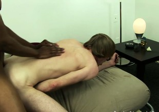 Cute light-complexioned twink gets his pain in the neck stretched by a big inky cock