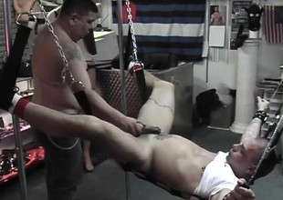 Master comforts slave with a quick handjob after destroying his butt