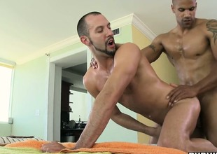 He keeps rubbing, but sticks his cock in his client's mouth, and ass