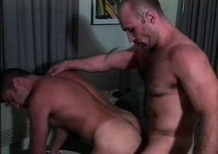 Two muscled gay guys in uniform are eager to enjoy a consenting anal fucking