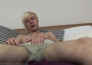 Gay clip of UK twink Phoenix lays on get under one's badroom table and u