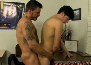 Tattooed stud slamming a twinks gaping ass like a maniac