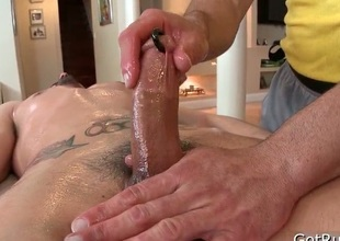 Dude gets his huge pierced dick massaged