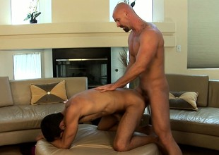 Huge gay baldhead bends his hunky lover relinquish and slides cock into his ass