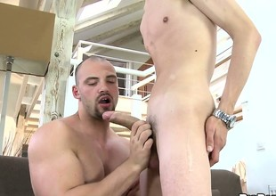 A hung twink and a bear exchange oral as they prepare to fuck