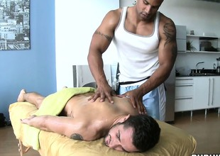 Big black bear massages a covetous white gay bore and gets a hardon