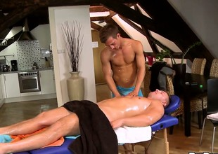 Horny skinny dude massages and gives head to a muscled gay guy
