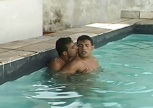 Horny gay dudes making out in the pool