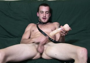 Freaky dude crippling a collar fucks his ass with a bunch of dildos