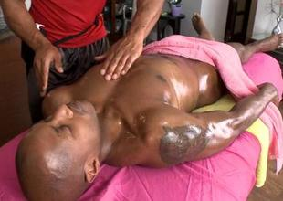 Gay masseur is giving fella a wild blowjob session
