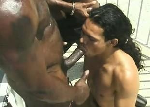 Huge monstrous black gentleman gets his dick stroked with an increment of sucked