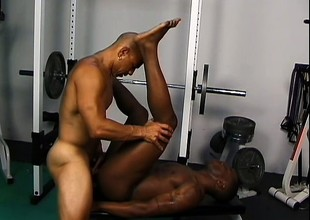 Ripped ebony studs make the gym into their personal sex square footage