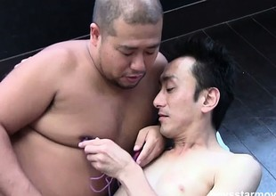 The Asian guys suck and stroke each other's rods until they reach their climax