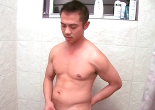 Asian gay dude jerking his jizzster