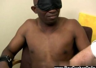 Blindfolded black man in bondage getting jacked off wits a fatso