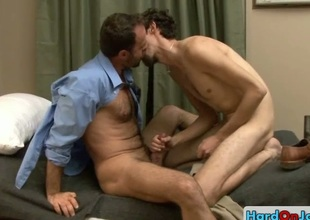 Hairy guy gets his cock sucked wits hunk