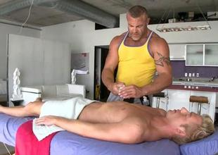 Lesbian masseur is giving dude a oralsex session