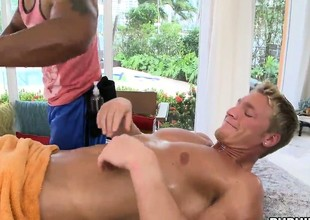 Enormous ebony muscleman giving his gay friend some erotic massage