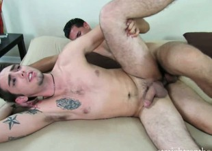He drills him doggy style, then rolls him over to fuck and cums connected with