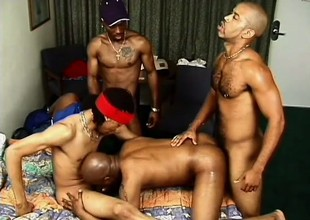Gangbangers get it on during an orgy with a slutty white boy