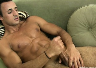 Lying on be passed on couch, be passed on young stud jerks his big cock until he enjoys intense pleasure