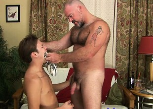 Buff hairy bear gets a young twink just about munch on his mature meat