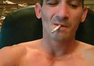 Tatooed tough pauper smokes while strokes his cock